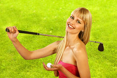 Golfing girl. Girl goes golfing with happy smile stock photo