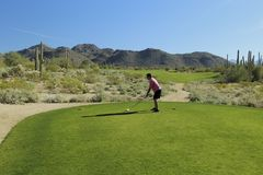 Golfing man Arizona desert Stock Photo