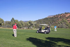 Golfing in Red Rock Country. Golfers hitting shots amongst the red rock country of sedona arizona stock image