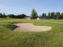 Golfing sand trap. Bunker on a golf course in the summer time Royalty Free Stock Images