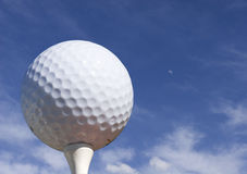 Golfing sky. Golf ball with blue sky and moon Stock Photo
