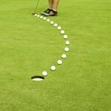 Golfing. Straight to the goal. Arrow made of balls Stock Image