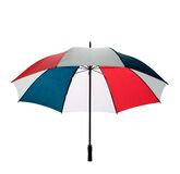 Golfing umbrella isolated. An open multicoloured golfing umbrella isolated on a white background with clipping path royalty free stock photos