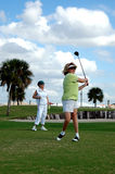 Golfing women Stock Photography