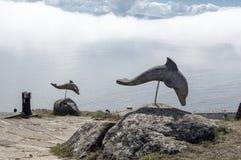 Golfinhos de pedra Imagens de Stock
