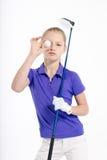Golfista bonito de la muchacha en el backgroud blanco en estudio Fotografía de archivo