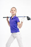 Golfista bonito de la muchacha en el backgroud blanco en estudio Fotos de archivo