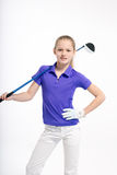 Golfista bonito de la muchacha en el backgroud blanco en estudio Imagen de archivo