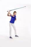Golfista bonito de la muchacha en el backgroud blanco en estudio Fotografía de archivo libre de regalías