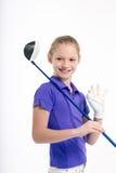 Golfista bonito de la muchacha en el backgroud blanco en estudio Imagen de archivo libre de regalías