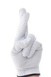 Golfista con los dedos cruzados Imagenes de archivo
