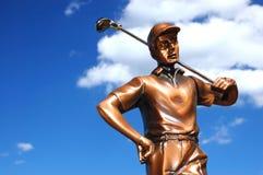 Golfista de bronce fotografía de archivo