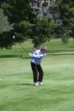Golfista de la mujer que junta con te apagado Fotografía de archivo