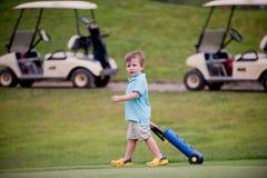 Golfista de Little Boy foto de archivo libre de regalías