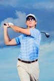 Golfista en la puesta del sol Fotos de archivo