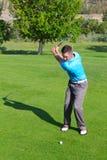 Golfista joven imagenes de archivo