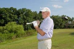 Golfista jubilado, mayor Imágenes de archivo libres de regalías
