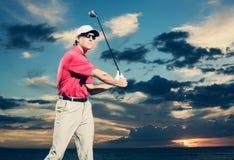 Golfista przy zmierzchem Obrazy Royalty Free