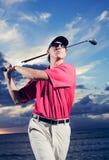 Golfista przy zmierzchem Fotografia Stock