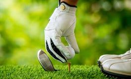 Golfista que junta con te apagado Foto de archivo