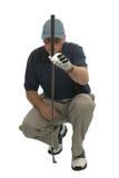 Golfista que se alinea un putt. Fotografía de archivo