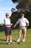 Golfistas en el rectángulo de la te Fotos de archivo