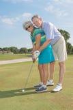 Golfistas mayores Imágenes de archivo libres de regalías