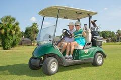 Golfistas mayores foto de archivo