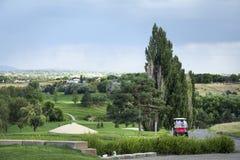 Golfkarren op landschap royalty-vrije stock foto's
