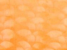 Golfpatroon op oranje stoffensuède Stock Afbeelding
