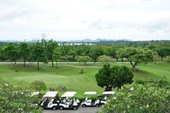 Golfplatz und Wagen Stockfotos