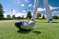 Golfplayer. The picture shows a female golf player to tee of stock photography