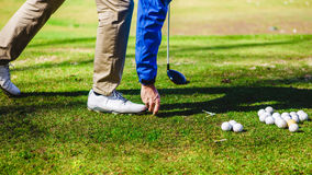Golfplayer and a ball. Golf ball club tee golfplayer close-up stock images