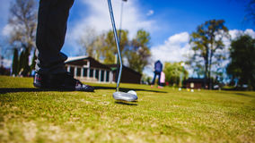 Golfplayer and a ball. Golf ball club tee golfplayer close-up royalty free stock photo
