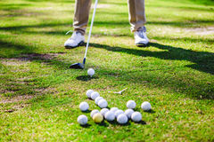 Golfplayer and a balls. Golf ball club tee golfplayer close-up royalty free stock photography