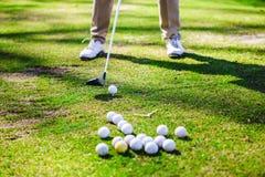 Golfplayer e bolas Fotografia de Stock Royalty Free