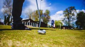Golfplayer e uma bola Foto de Stock Royalty Free
