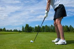 A Golfplayer with Golf ball  on golf course Royalty Free Stock Photos