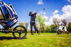 Golfplayer hits a ball. On the grass royalty free stock photos