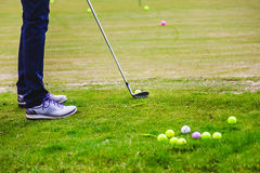 Golfplayer hits a ball. On the grass stock images