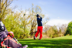Golfplayer hits a ball. On the grass royalty free stock photography