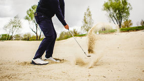 Golfplayer hits a ball Royalty Free Stock Images