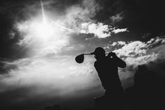 Golfplayer hits a ball. Silhouette royalty free stock photos