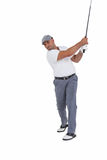 Golfplayer taking a shot. On white background royalty free stock photography