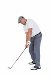 Golfplayer about to swing a golf ball royalty free stock photo