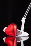 Golfputter und Liebessymbol Stockfoto