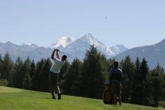 Golfschwingen in Crans-Montana Stockbilder