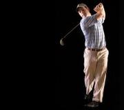 Golfschwingen getrennt auf Schwarzem Stockfoto
