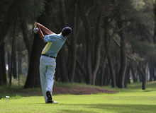 Golfschwingen im riva dei tessali Lizenzfreies Stockbild