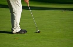 Golfsetzen Stockbild